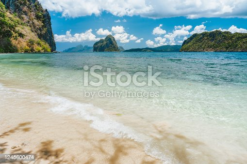 Secluded beach on Lagen island with view to Pinagbuyutan island. El Nido, Palawan, Philippines.