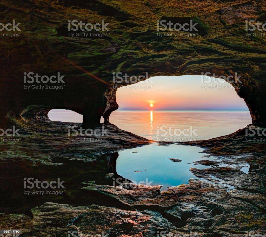 Secluded Sea Cave Sundown stock photo