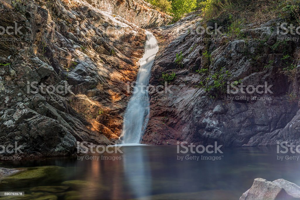 Secluded waterfall on the mountains in Corsica - 2 royaltyfri bildbanksbilder