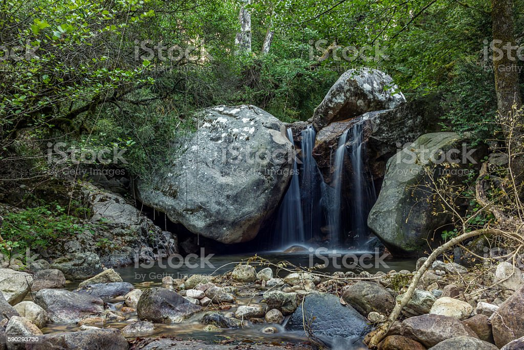 Secluded waterfall on the mountains in Corsica - 3 royaltyfri bildbanksbilder
