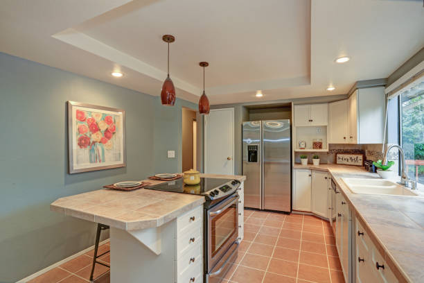 Second floor Kitchen boasts tray ceiling, island stock photo