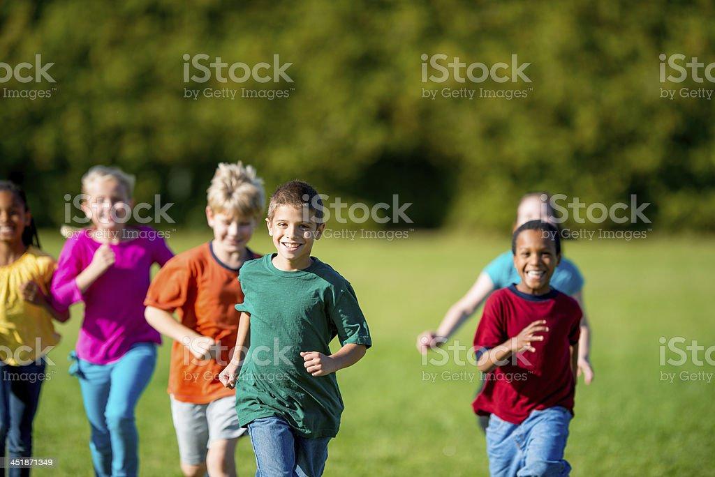 Second Grade Class Running at Recess royalty-free stock photo