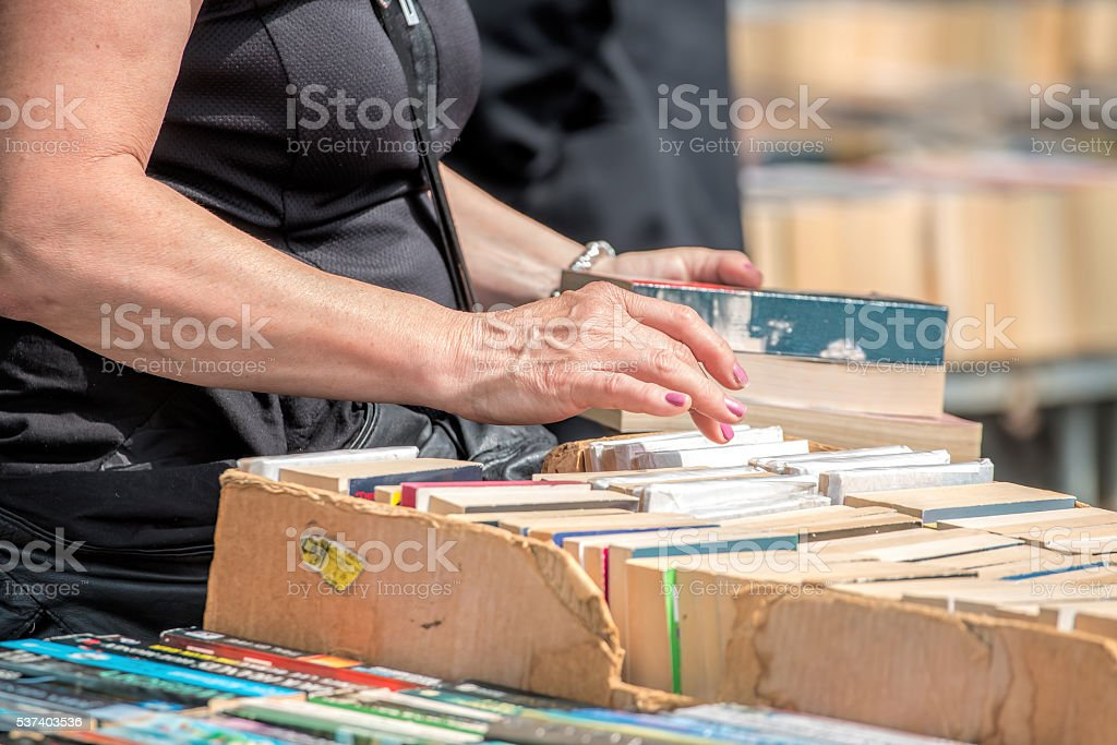 Second Hand Book Stall. Woman Buying Books stock photo