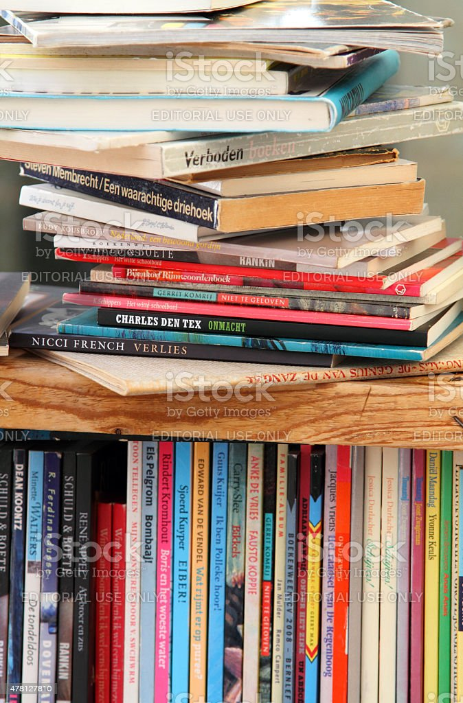 Second hand books displayed on a stall stock photo