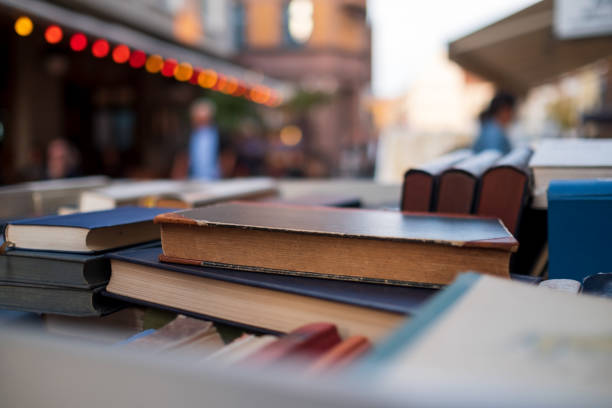 Second hand books for sale in a street book market stock photo