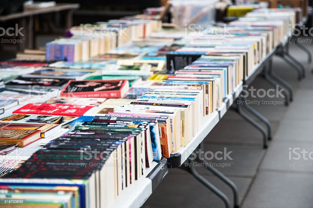 second hand books for sale in open air market stock photo