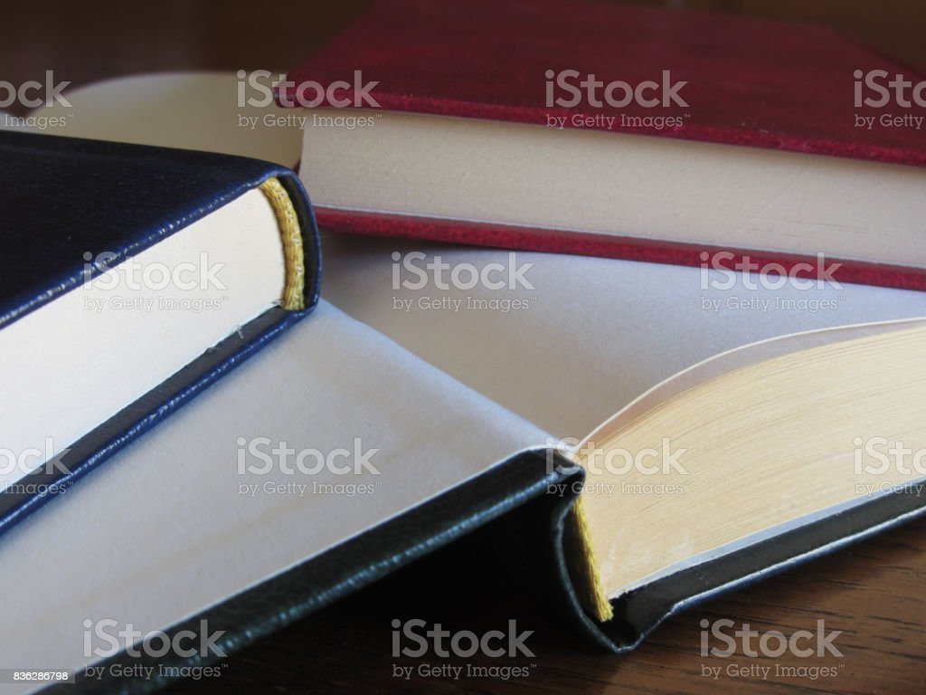 Second hand books with blank pages on a wooden table stock photo