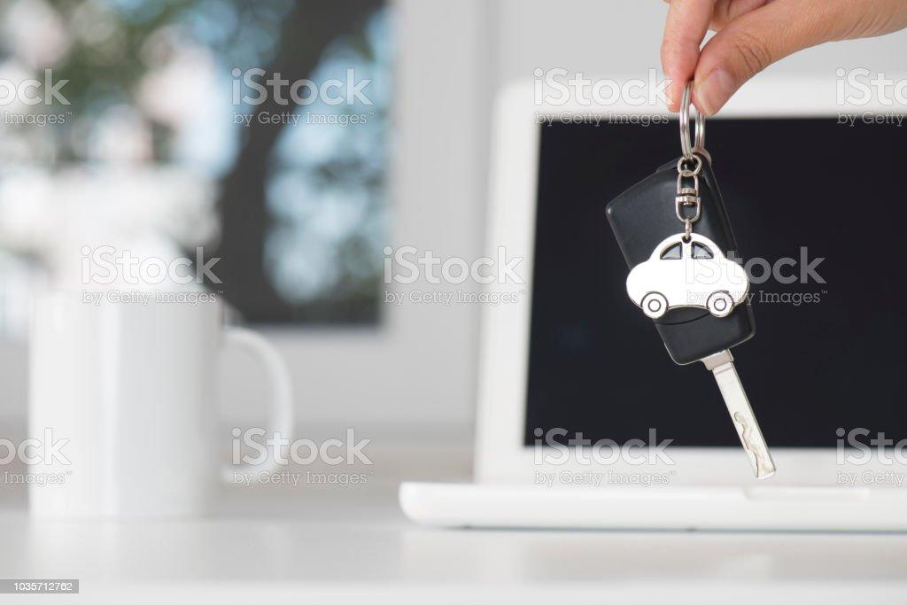 Woman giving car key.