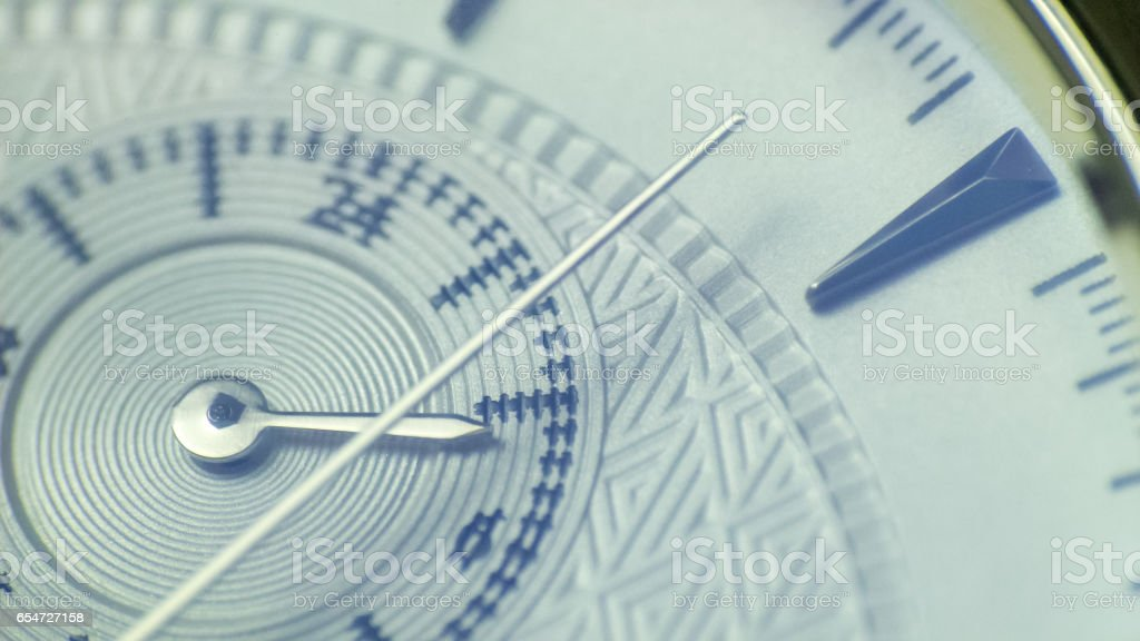 Second hand close up on white dial watch stock photo