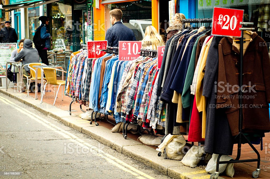 Second hand clothes on a market stall stock photo
