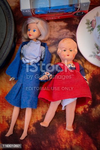 Second hand dolls, left one is collecteurs item, a KLM royal dutch airline stewardess first class gift doll On montmartre flea market in Gouda, Netherlands