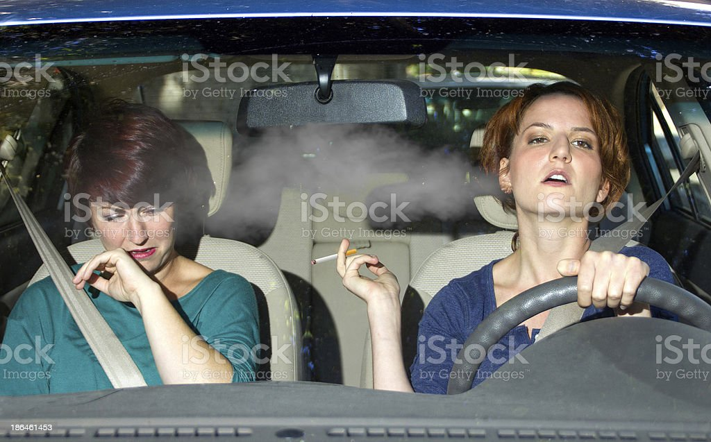 Second Hand Smoke From a Driver Smoking in a Car royalty-free stock photo