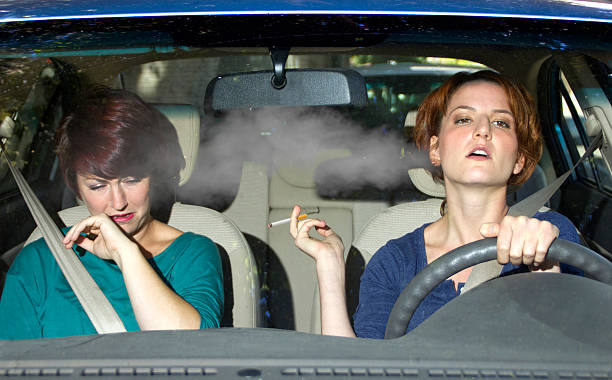 Second Hand Smoke From a Driver Smoking in a Car stock photo