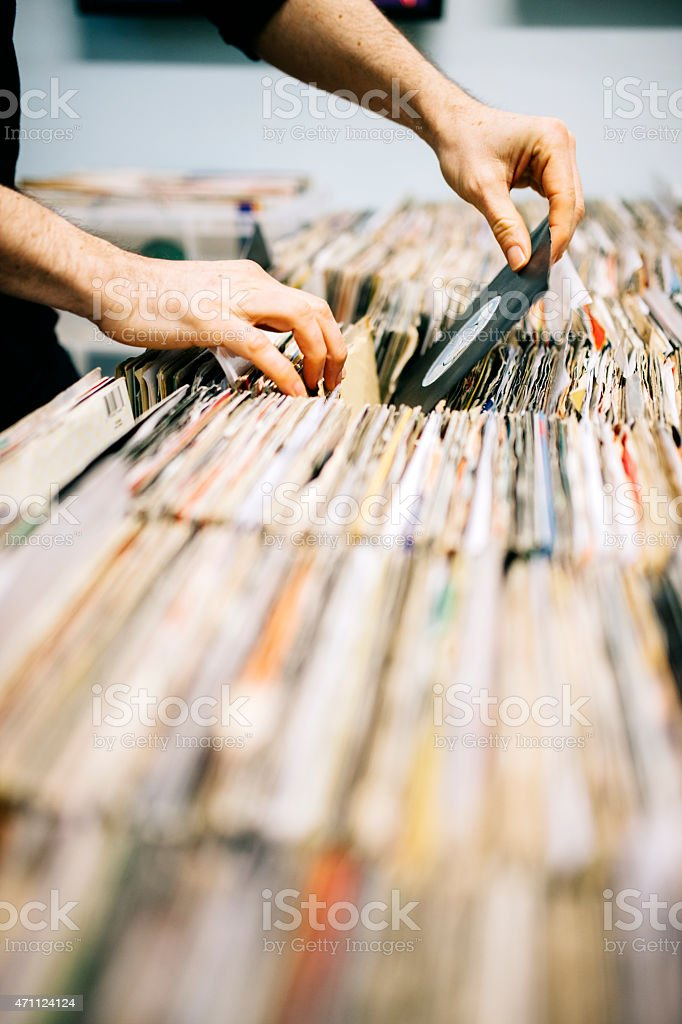 Second hand vinyl records in a record store, hands searching stock photo