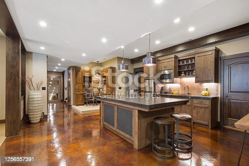 Showcase home with glossy basement flooring and large kitchen