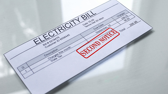 Second Notice Seal Stamped On Electricity Bill Payment For