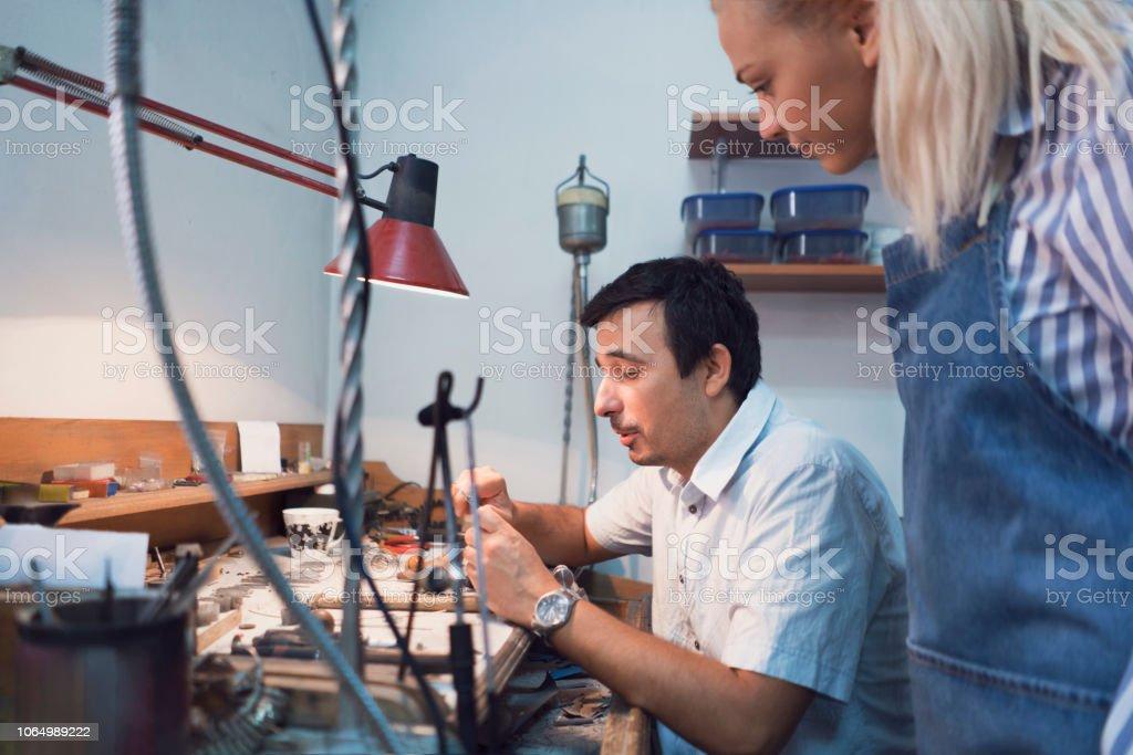 Female trainee watching process of making jewelry
