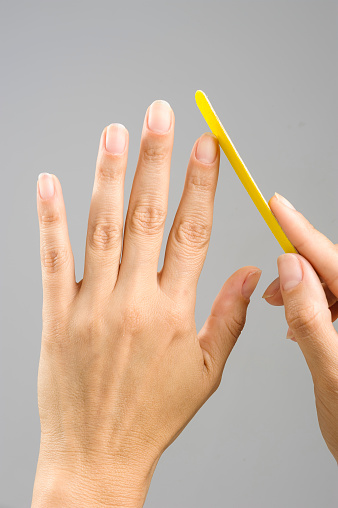 istock Second step by step of a french manicure, Buffing the nails. 1174474666