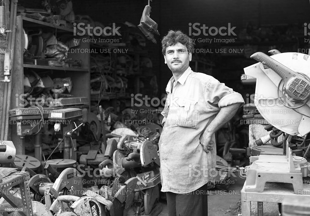 Secondhand Electric Saw and Power tools shop at Shershah Scrapyard stock photo