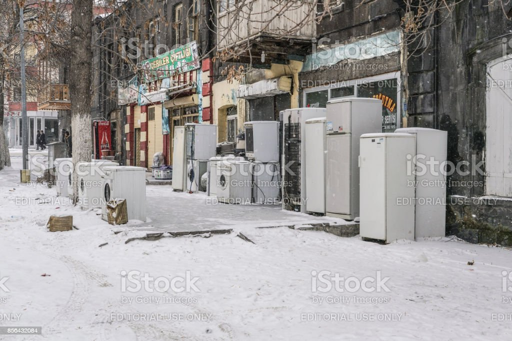 Secondhand White Goods piled up outside of shop in Turkey. stock photo
