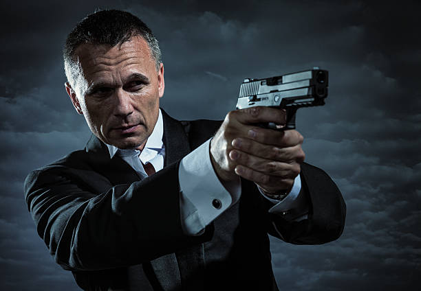 Secret Agent Armed With Handgun stock photo
