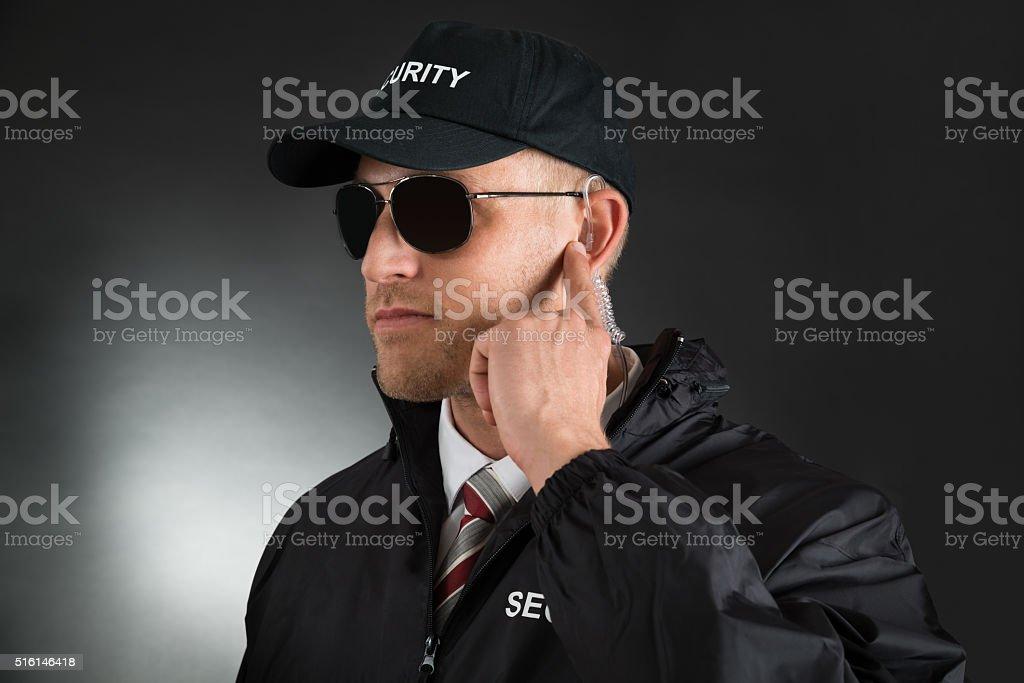 Secret Agent Listening To Earpiece stock photo