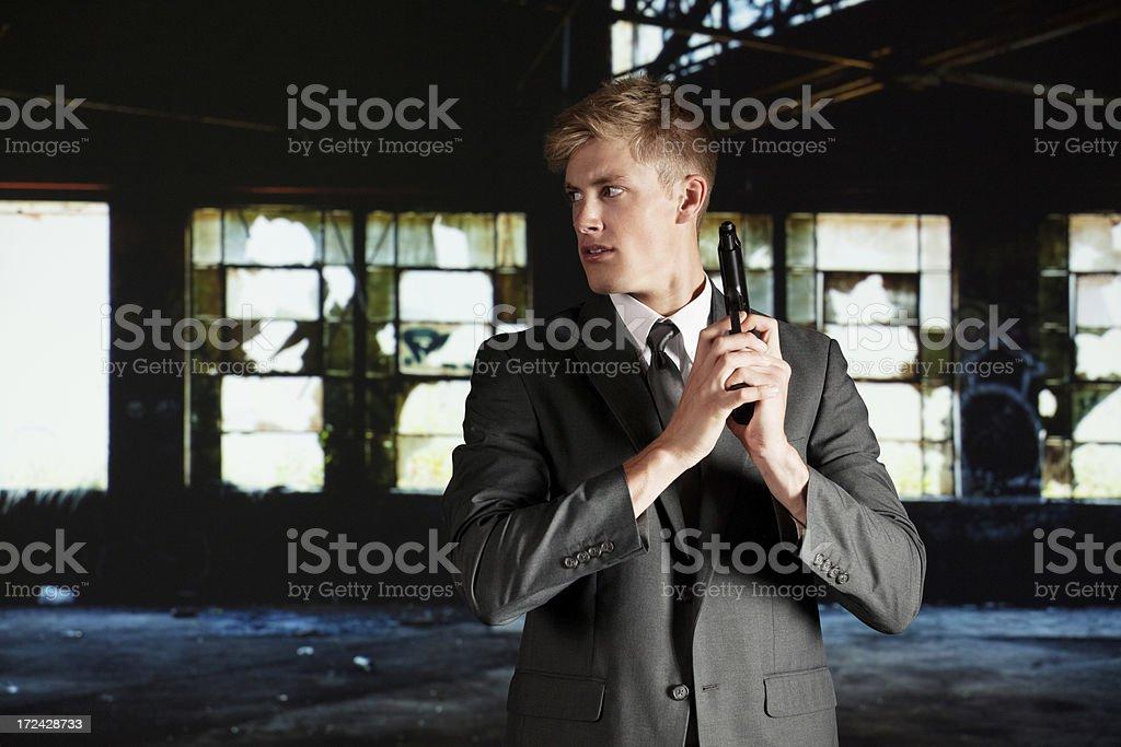 Secret agent with handgun royalty-free stock photo