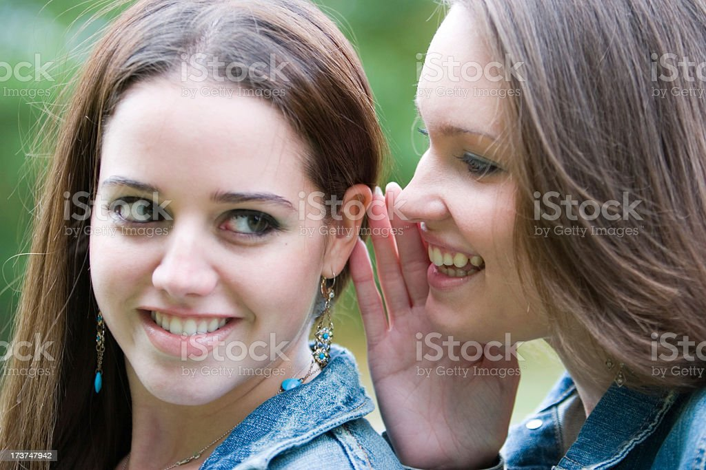 Secret between friends royalty-free stock photo