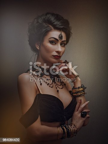 istock Secret face. Mata Hari. Belly Dancer. Ethno styled female portrait with oriental bijou 984084420