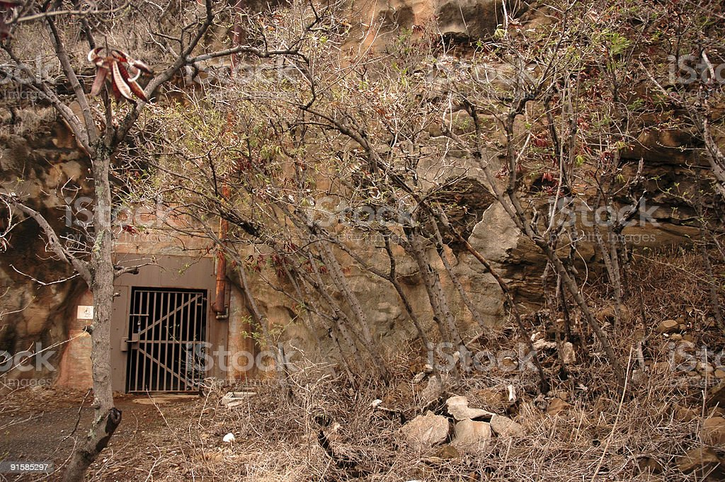 Secret gate entrance into side of mountain stock photo