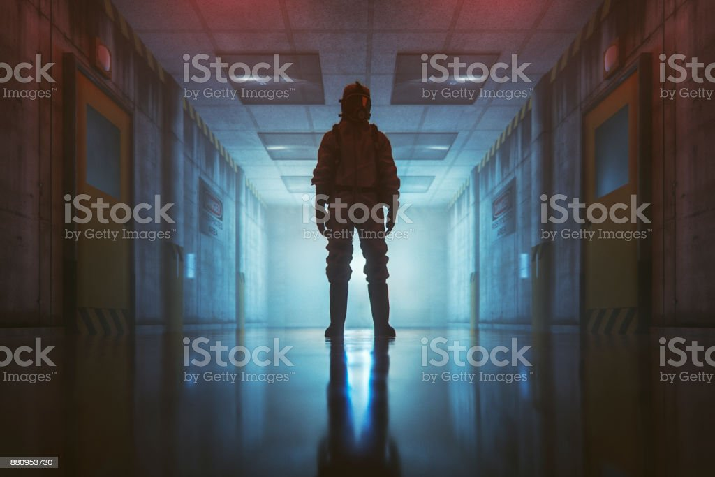 Secret government underground facility with standing man in hazmat suit stock photo