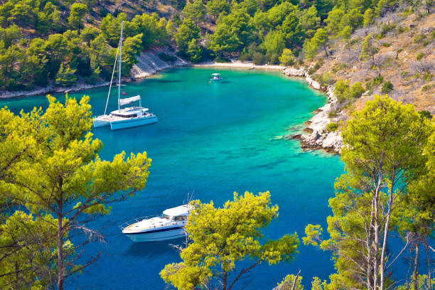 Secret turquoise beach yachting and sailing, Island of Brac, Dalmatia, Croatia Secret turquoise beach yachting and sailing, Island of Brac, Dalmatia, Croatia croatian culture stock pictures, royalty-free photos & images