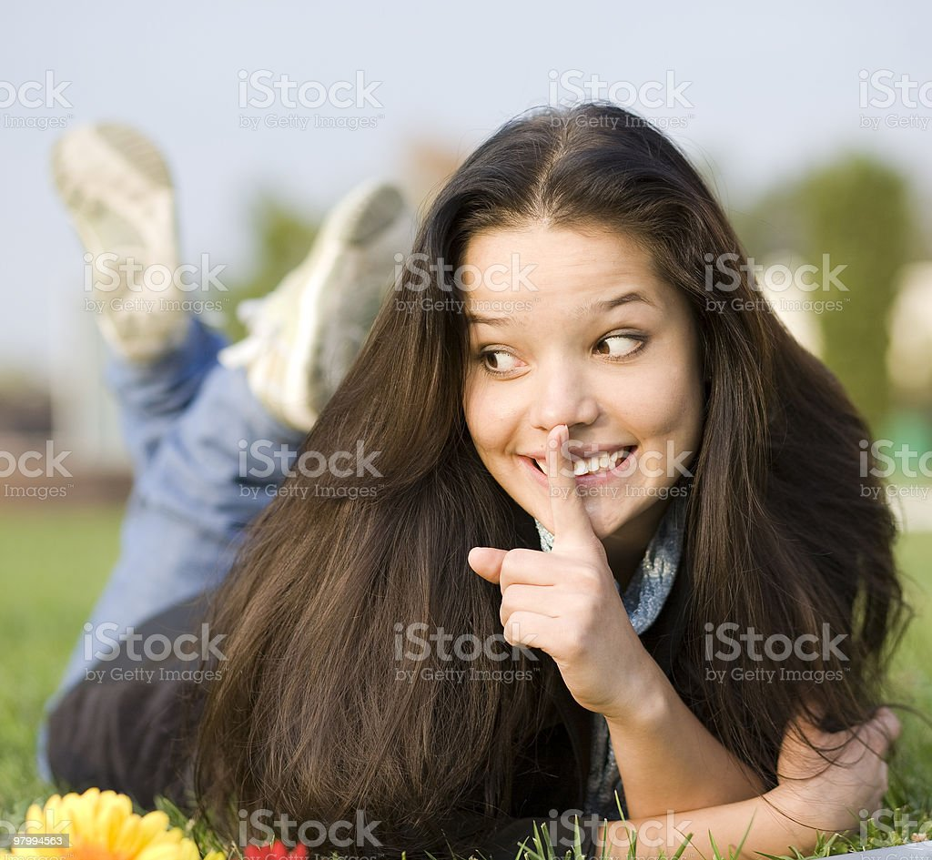 Secret. Woman at the summer park royalty free stockfoto