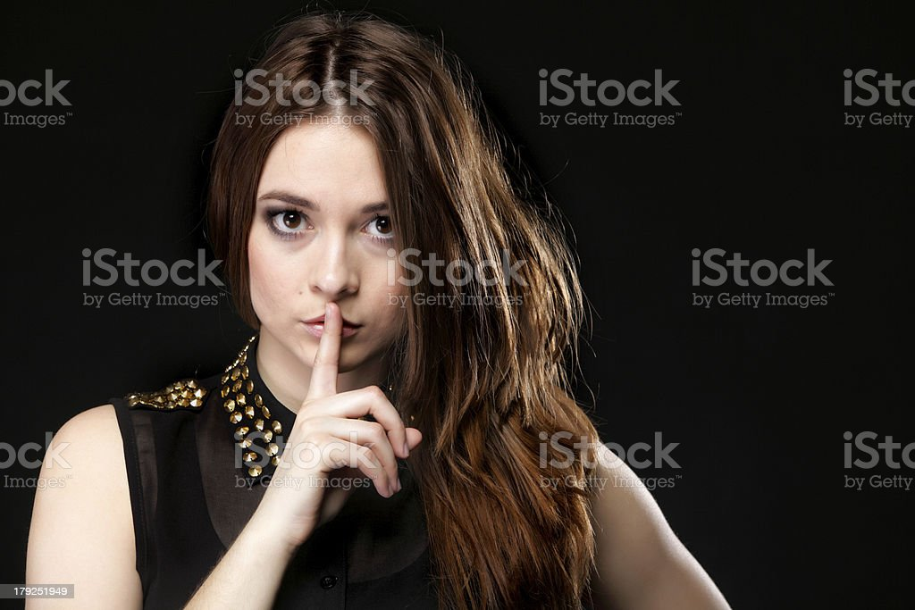 Secret woman. Girl showing hand silence sign royalty-free stock photo