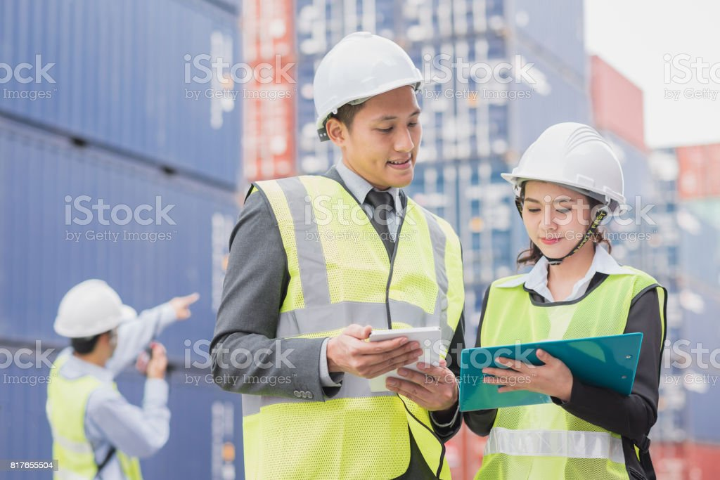 Secretary and businessman in logistic, export, import industry with shipping cargo container freight stock photo