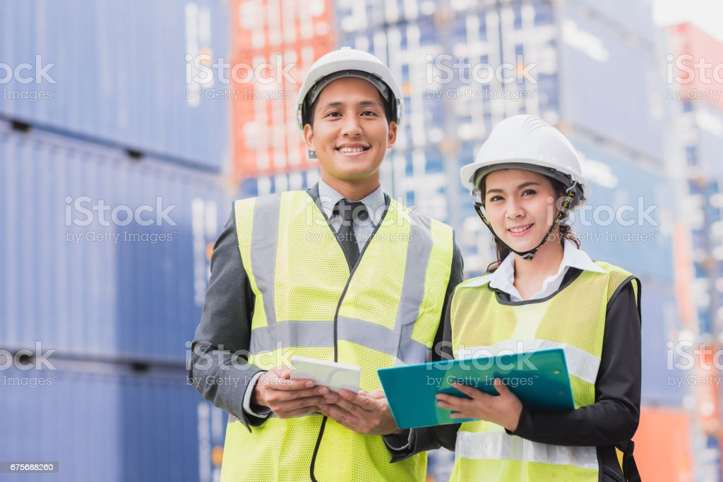 Secretary and businessman with shipping cargo container freight in background stock photo