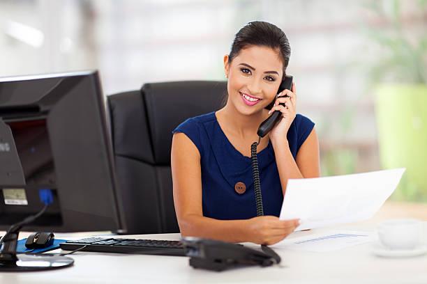 secretary answering telephone stock photo