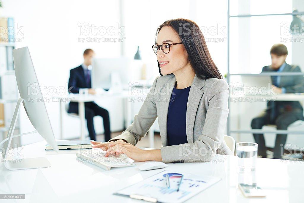 Secretary in office stock photo