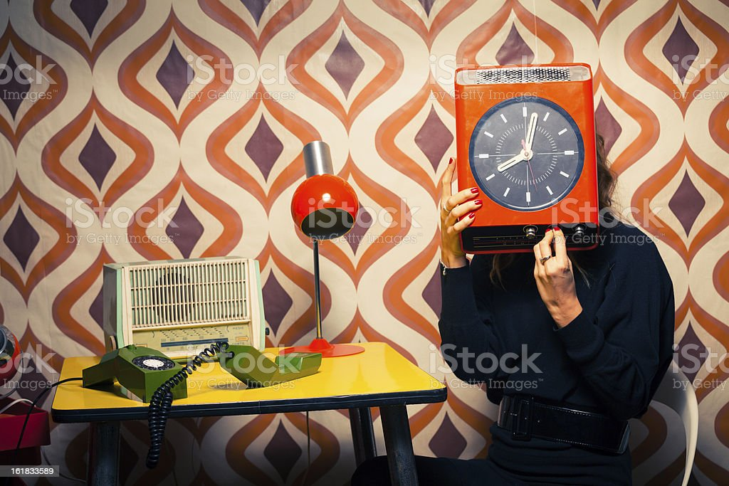 Secretary in Vintage Office holding a Clock royalty-free stock photo