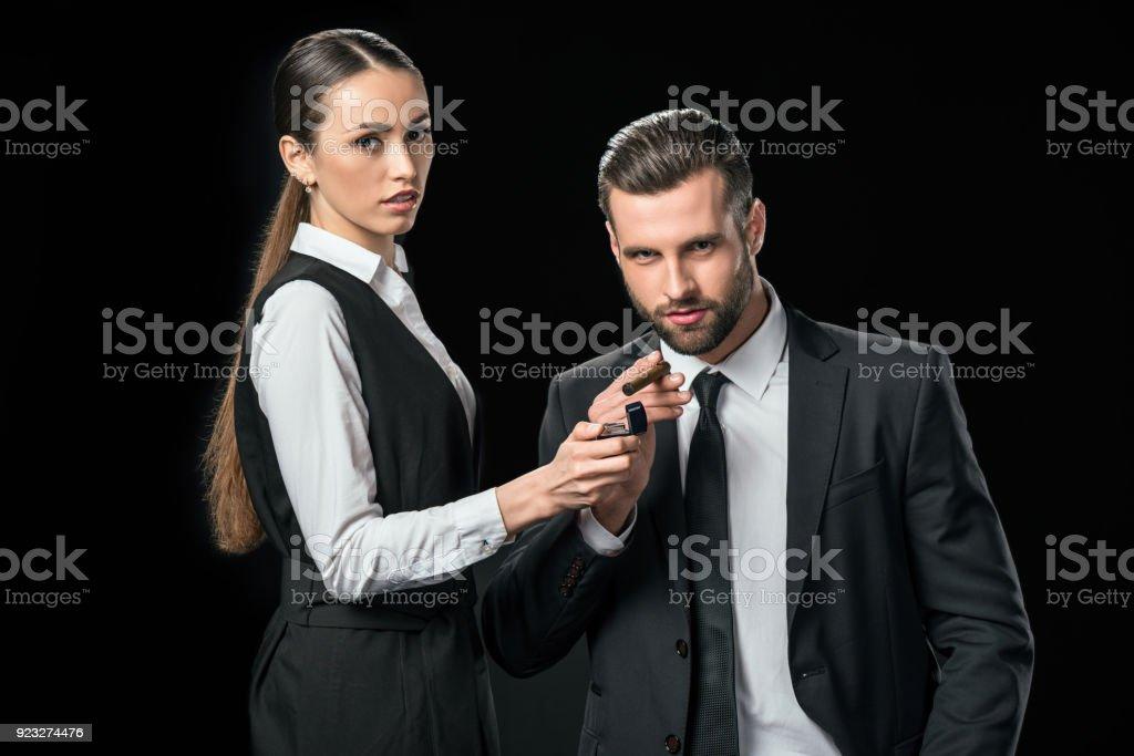 secretary lightning cigar for boss, isolated on black