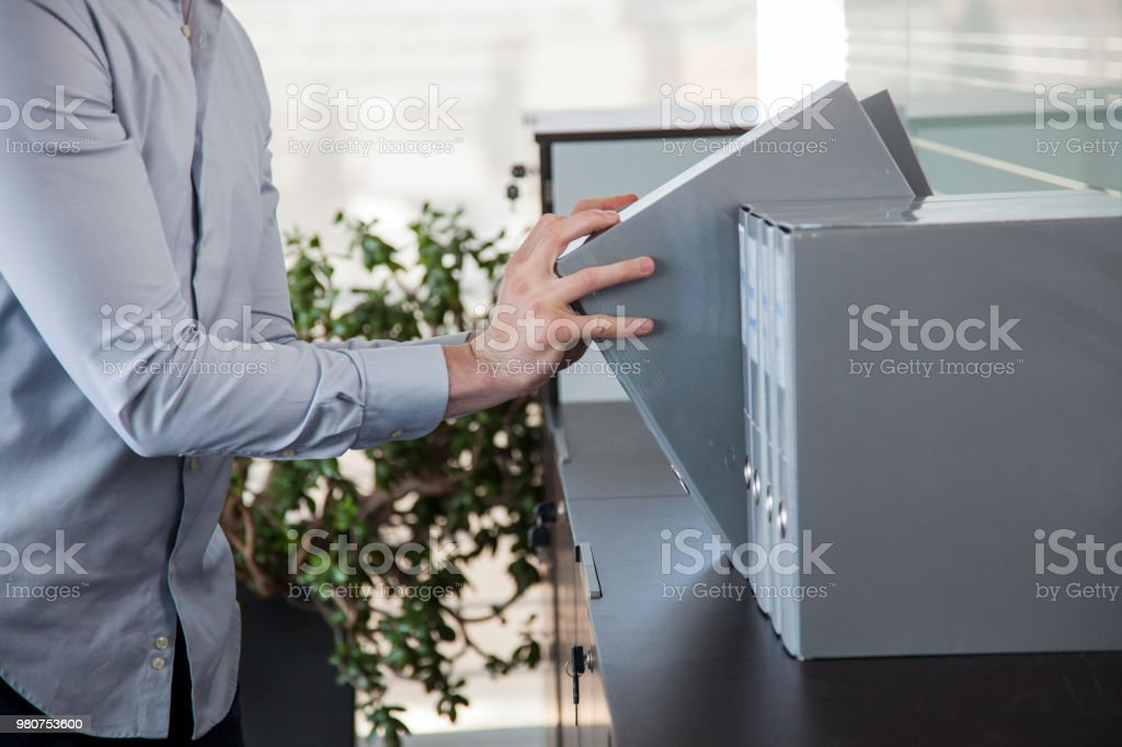 Secretary taking paper record in an office stock photo