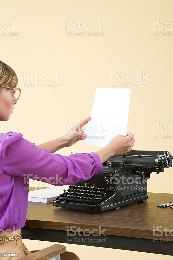 A secretary using a typewriter royalty-free stock photo
