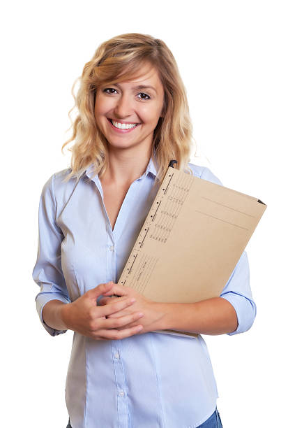 Secretary with curly blond hair and document stock photo