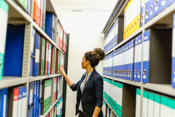 Secretary woman in basement archive Woman working in Accounting office bureaucracy stock pictures, royalty-free photos & images
