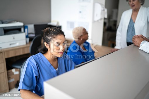 istock Secretary working at hospital reception 1199231029