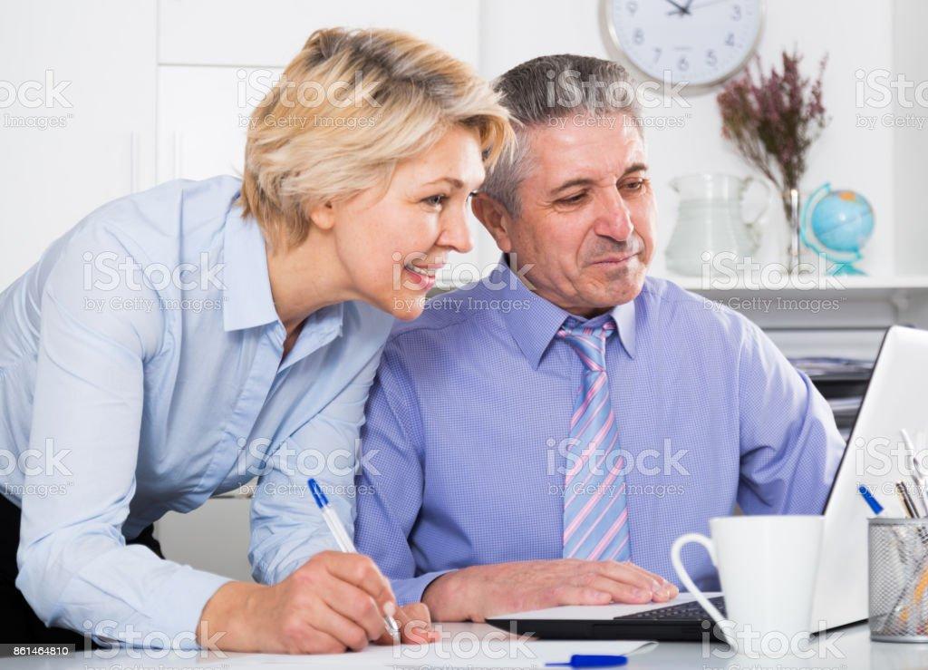 Secretary writes down tasks of chief stock photo