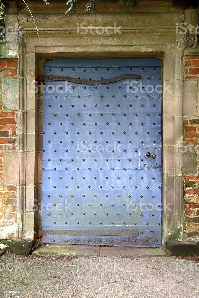 Secretive old blue door stock photo