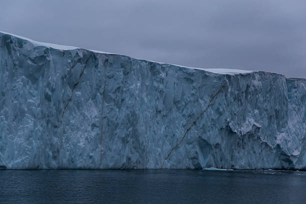 section of a large iceberg - アイスクライミング ストックフォトと画像