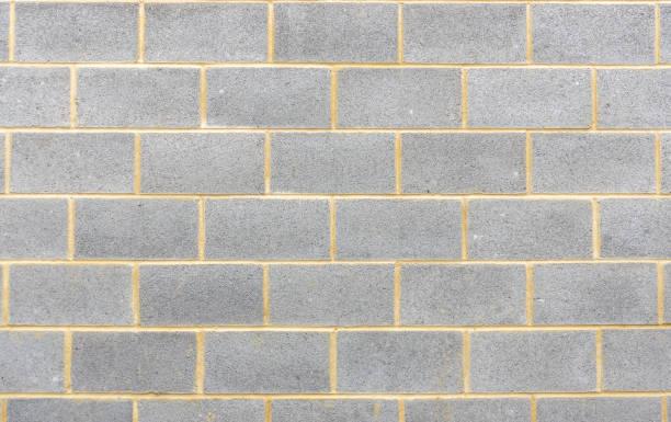 abschnitt der brise block wand hintergrund - betonblock wände stock-fotos und bilder
