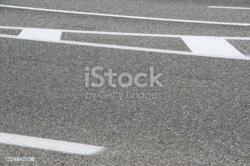 833130962 istock photo section of dry asphalt road with road markings 1224642156